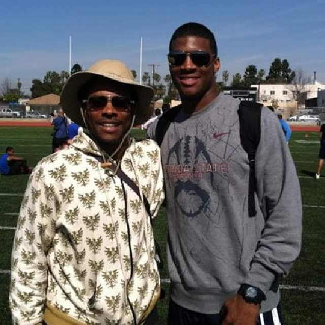 Coach Rhodes and Jameis Winston